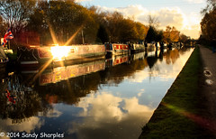 Bridgewater Canal - Stretford (Explored) (Sandy Sharples) Tags: uk autumn trees reflection fall water manchester canal lensflare riverboat barge towpath bridgewater stretford