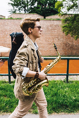 Young woman walk with her saxophone (PrgomeljaDusanAna) Tags: light portrait people musician music woman white black girl beautiful beauty hat fashion lady female club standing hair studio person clothing concert model pretty artist play adult expression background performance young jazz blues style entertainment musical human talent sound instrument attractive elegant performer sax brass saxophone isolated elegance caucasian saxophonist