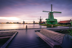 There's no one waiting... (miguel_lorente) Tags: longexposure sunset sky green water windmill amsterdam clouds river bench landscape dock zaanseschans zaan