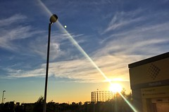 16-143 (Gray Singer) Tags: sunset silhouette clouds structure lamppost flare gasmeter etihadstadium
