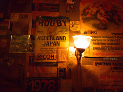 Rugby (Art By Pem Photography: Tao Of The Wandering Eye) Tags: travel light shadow sports netherlands amsterdam sport japan bar poster lumix photo flyer europa europe glow shadows rugby nederland eu panasonic photograph posters 1978 bulletinboard flyers ricoh fineartphotography lightfixtures dmcfz28 cafelusthof