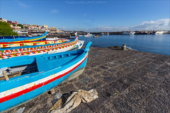 the colors of the sea (gaetanolarocca) Tags: blue sea sky seascape colors port canon landscape boats wide sicily catania sicilia 1022 acitrezza faraglioni malavoglia