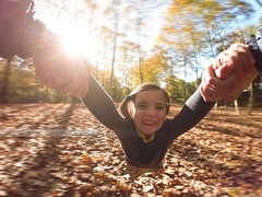 Girl Spin. (arturii!) Tags: autumn light sunset girl smile smiling forest airplane flying holding hands europe shadows arms action pov air spin sunny catalonia round spinning nena leafs rotating sunbeams bosc turnaround firstpersonview canyamars girar giprohero3