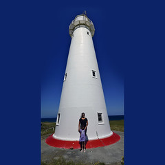 Cape_Egmont_Lighthouse_Vertical_Panorama_Square_02 (Aaron & Radhika) Tags: ocean camera new family blue light sky panorama lighthouse house holiday distortion west tower art up vertical composition photoshop square coast nikon artist photographer post aaron daughter perspective mother perspectives optical mum zealand together adobe wife cape dslr processed upward taranaki egmont verticality cs5 openshaw d3100