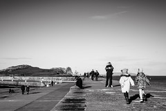 sit.hug.run (gabor images) Tags: street ireland sea people howth dublin kids blackwhite walk candid streetphotography irishsea gaborimages