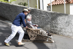 Madeira sledge with toboggan (compuinfoto) Tags: street people woman man tourism portugal hat wall fun belt basket slow ride traditional skating working cage tourist downhill monte sled wicker sleigh tobogganing job madeira attraction funchal obsolete toboggan oldfashioned riders traditionalculture pushing occupation traditionalclothing colorimage toboggane streetsoflondonwn
