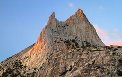 Cathedral Peak at Dusk (Xuberant Noodle) Tags: california ca sunset red orange sun mountain rock set fire climb dusk peak yosemite