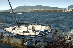 on the rocks (tesseract33) Tags: world travel winter light art vancouver sailboat boats outside nikon shipwreck disaster kitsilano sailboats nikondigital d300 nikond300 tesseract33 peterlangphotography squamishphotographer