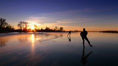 Skating away until the twilight fell (Bn) Tags: winter sunset lake cold holland ice netherlands dutch de geese meer die tour natural bevroren outdoor skating over n nederland cities skaters gans freeze skate op wintertime iconic eleven topf200 januari iceskate waterland schaatsen the schaats greylag holysloot elfstedentocht ransdorp grauwe 200faves natuurijs gekte ijstochten holysloter ganzentijd
