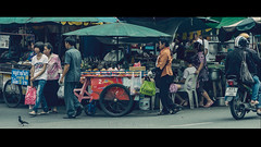 Moving Through The Day (Sound Quality) Tags: street travel people food cinema colour bird fruit shopping movie lunch thailand moving asia day bangkok pigeon streetphotography stall scooter clip explore motorbike kiosk cart cinematic carts journalism khaosan anamorphic khaosanroad morotcycle whatsforlunch spirit7628yahoocom httpwwwflickrcomphotosmichaelwashingtonphotography
