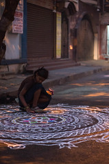 Girl with Rangoli (TAZMPictures) Tags: india night chennai pongal bhogi kolam rangoli triplicane