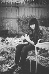 Anna and Rainbow (Kilkennycat) Tags: portrait blackandwhite bw pet chicken girl cat canon furry backyard child whiskers 500d kilkennycat t1i ryanconners