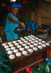 Ethiopian woman filled coffe cups in a bar, Semien wollo zone, Woldia, Ethiopia (Eric Lafforgue) Tags: africa woman color cup coffee vertical bar outdoors cafe women forsale adult drink traditional beverage ceremony culture coffeeshop pot indoors mug ethiopia caffeine foodanddrink hospitality coffeebreak coffeepot coffeemaker hornofafrica ethiopian eastafrica thiopien etiopia hotdrink blackcoffee abyssinia ethiopie etiopa onewomanonly  etiopija 1people ethiopi  nonalcoholicbeverage etiopien etipia  etiyopya     woldia   ethiopianculture    semienwollozone endamechone rayakobo ethio161598