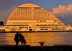 Reflections of the evening light (Giovanni88Ant) Tags: sea orange reflections hotel evening kobe