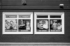 Boardwalk Signs (LXG_Photos) Tags: signs film window monochrome store kodak pacificbeach canonetql17 tmax100