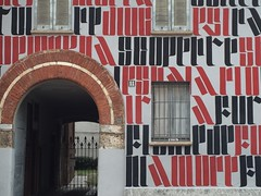 unusual house (Hayashina) Tags: italy house milan colour window arch blackandred