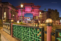 The Tourist (alundisleyimages@gmail.com) Tags: longexposure people art tourism weather architecture night liverpool fence twilight chinatown dusk chinese culture structure bluehour attraction merseyside imperialarch