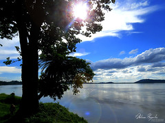 Contrasting Hues of a Paradise Unexplored (Abhinav Hazarika) Tags: blue trees light sunset sky sun sunlight india green silhouette clouds sunrise canon river powershot flare huge sunrays assam mighty hs canonpowershot abhinav brahmaputra 50x hazarika sx50 canonsx50