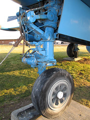 Nose Gear detail (Lunken Spotter) Tags: ohio wheel rural plane airplane evening flying memorial aviation military airplanes wheels flight navy engine tire baltimore tires engines landinggear planes oh propellers preserved roadside naval usnavy patrol prop tyre veterans evenings p2 coldwar vfw navalaviation veteransmemorial usmilitary veteransofforeignwars asw nosegear antisubmarine p2v antisubmarinewarfare ruralohio centralohio lockheedp2vneptune preservedaircraft birddirt vfwpost 131522 sp2e patrolplane noselandinggear preservedairplane lockheedp2neptune p2v5fs vfwpost3761 roadsideairplane