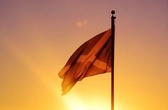 A Scottish Sunset (Michelle O'Connell Photography) Tags: winter sunset sky orange heritage colors silhouette st scotland twilight andrews colours alba dusk glasgow flag scottish pastels colourful flagpole wintersky saltire lanarkshire drumchapel scotlandflag skyporn newkilpatrick drumchapelglasgow hoousing inchfaddrive drumchapellifesofar michelleoconnellphotography