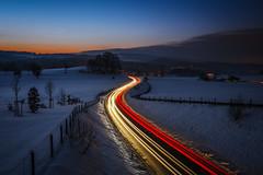 Happy New Year / よいおとしを (Sandro Bisaro) Tags: road longexposure schnee snow trafficlights canon landscape schweiz switzerland lowlight suisse lighttrails landschaft langzeitbelichtung traffictrails lightstream canon5dmarkiii sandrobisaro canon1635mmf4lis