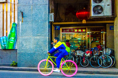 Out the window. Pink Tyres. (dagboshoots) Tags: china street travel pink color colour green window bike asia cyclist taxi cycle worker dagbo
