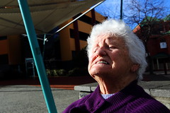 (paralelsuns85) Tags: street color colour lady female canon pain women colorful aqua purple candid streetphotography courtyard elderly tasmania grimace colourful unposed carpark wrinkles canonef2470mmf28lusm burnie whitehair canon6d