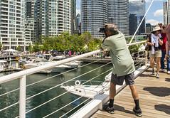 City Photographer (fotofrysk) Tags: camera bridge toronto ontario canada man marina boats photographer harbour harbourfront condos lakeontario torontoislands 5515 amsterdambridge nikond7100