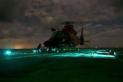 Shipboard landing in Gulf of Mexico (U.S. Coast Guard) Tags: gulfofmexico unitedstates tx houston helicopter cutter uscg nightoperations uscgcdauntless mh65dolphin airstationcorpuschristi hotrefuel padethouston pa3emery