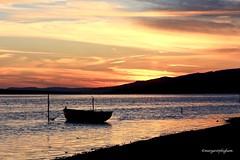 Alone (Margaret Preuss-Higham) Tags: serene atmospheric meteorology boat water summertime sunset dorset thefleet