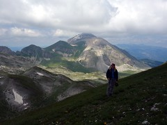 Edita looks up at Pizzo Cefalone, with Monte Corvo behind (markhorrell) Tags: italy walking abruzzo gransasso apennines pizzocefalone