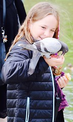 Cute Girl Playing! (kekaneshrikant) Tags: portrait bird smile laughing canon copenhagen denmark pigeon jacket slot 2016 scandic rosensberg eos80d scandanevia