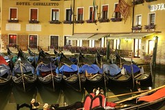 Gondolas parked up for the night (lucyrickerby) Tags: travel venice italy holiday night canon nightshot streetphotography nighttime nightlight gondola canon6d