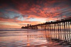 Oceanside Pier (KrissyM_77) Tags: oceanside california socal sunset ocean waves pink orange pier landscape clouds beach reflection