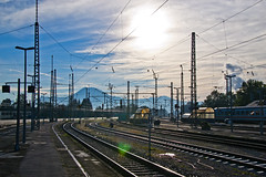 Freilassing railway station (echumachenco) Tags: freilassing gaisberg bahnhof railwaystation tracks train pylon cable sky cloud sun contrejour fhn berchtesgadenerland bavaria bayern germany deutschland nikond3100 october autumn infrastructure
