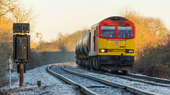 A lovely crisp December morning sees DB Class 60 no 60040 approaching the Diamond Crossing at Newark on 06-12-2014 with a Lindsey to Kingsbury loaded oil train (kevaruka) Tags: uk greatbritain autumn england sun cold color colour colors sunshine contrast train canon flickr december colours dof unitedkingdom sunny trains frosty db 5d tug newark frontpage britishrail nottinghamshire charter sunnyday steamtrain 2014 canon100400l networkrail newarkcastle decembersun class60 newarknorthgate 60040 dbschenker canon5dmk3 railcharter 5dmk3 5d3 5diii canoneos5dmk3 newarkdiamondcrossing ilobsterit