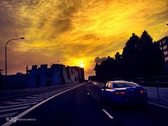 Journey towards the glowing Sunset (Sanirozwerkz) Tags: travel sunset sky clouds skyscape lights singapore cityscape sunsetlight goldenlight worldcapture