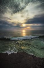 Tanah Lot coastline - Bali (sparqx) Tags: ocean sunset sea bali cloud sun reflection rock clouds canon indonesia coast waves horizon foam coastline hindu tanahlot balinese rockformation sunsetoverthesea waynewilliams eos7d sparqx