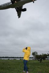 Gravelly Point 9700 (yospyn) Tags: yellow arlington virginia raincoat gravellypoint airplanelanding cloudyrain