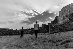 Like Father,Like Son | Golconda Fort,Hyderabad. (vjisin) Tags: travel boy blackandwhite india monochrome architecture asia fort outdoor islam father son hyderabad indianboy travelphotography indianman mughalarchitecture golcondafort