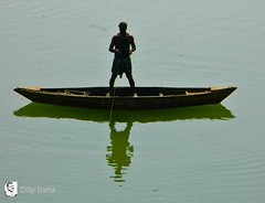 Man with his Boat- river connection (Dilip Datta) Tags: shadow fish man river photography boat fishing flickr theman boatman flickrphoto    shilluate dilipdattasphoto riverconnection manwithhisboat