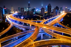 Shanghai skyline (Patrick Foto ;)) Tags: china road street city bridge blue light urban motion blur building beautiful skyline architecture modern night speed way movement highway colorful asia downtown cityscape view purple shanghai traffic district transport fast overpass landmark scene aerial junction viaduct business busy rush transportation intersection elevated curve overlook financial metropolitan futuristic interchange