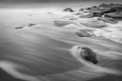 Tidal Surge (Thomas Pohlig) Tags: ocean sea blackandwhite water monochrome landscape newjersey sand rocks waves jetty calm jersey series capemaypoint serene jerseyshore seashore rockpile oceanwaves