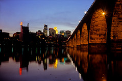 stone arch twighlight (Ron Layters) Tags: allihadwasarangefinderandatripod stonearchbridge mississippiriver cityskyline bridge evening skyline reflection arches cityscape saintanthonyfalls downtown lights night nocturneyellow blue stone arch eveninglight thetwincities minneapolis minnesota unitedstates usa america slidefilmthenscanned slide transparency fujichrome velvia leicam6 leica m6 ronlayters