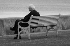 looking at the sea 03 (byronv2) Tags: edinburgh edimbourg scotland coast coastal rnbforth firthofforth forth river riverforth sea northsea portobello promenade seafront bench banc candid peoplewatching street blackandwhite blackwhite bw monochrome seat seated sitting people sit