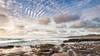 Furrowed Sky (Nick Twyford) Tags: newzealand seascape clouds rocks waves auckland nz northisland westcoast muriwai lateafternoonlight rockplatform colourimage leefilters nikond800 lee09nd lee06gnd nikkor160350mmf40 solmetageotaggerpro2