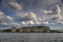 Stockholm Boat Tour (Tony Shertila) Tags: travel bridge sky lake water weather architecture clouds reflections boat europe day cloudy sweden stockholm tourist hdr kungsholmen mlaren langholmen lillaessingen stadshagen