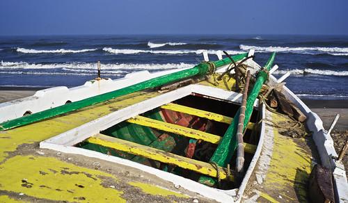 Wood boat on the beach on Mediterranean Sea, Port Said, Egypt