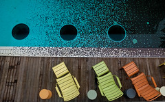 Three to rest (Leon Sammartino) Tags: from above blue summer orange art pool yellow hotel singapore top mosaic aerial lime poolside portholes