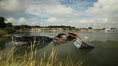 three wrecks (Mark Rigler UK) Tags: sea rot water clouds boats bay three rust decay bluesky holes dorset sunk poole